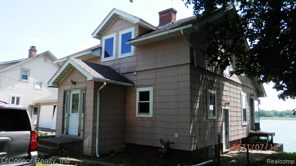 """Diamond in the rough - This 1900+ sq. ft. home has 87 feet of frontage on picturesque St. Clair River. Some updates were started but needs completion. You can make this """"your home"""" with some final touches. Home offers 2 bedrooms, 2 baths, full basement with exterior access and more."""