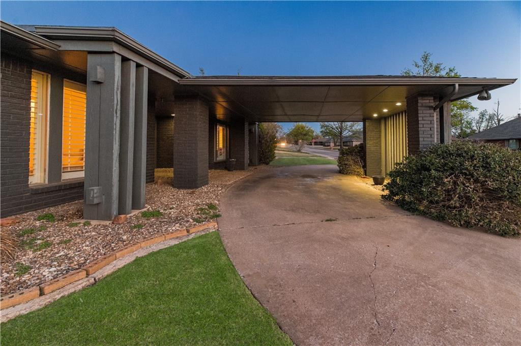 This home sits on a large corner lot and is located in one of NW OKC's most desired neighborhoods- Quail Creek. Prepare to fall in love when you walk into the unique double door entrance. This Mid Century Modern home features a Mother In law floor plan. It has 4 bedrooms, 2.5 baths, a double sided fireplace, and a large media room.There is ample parking with a circle driveway, covered carport and rear parking. A little TLC would make this home truly remarkable.