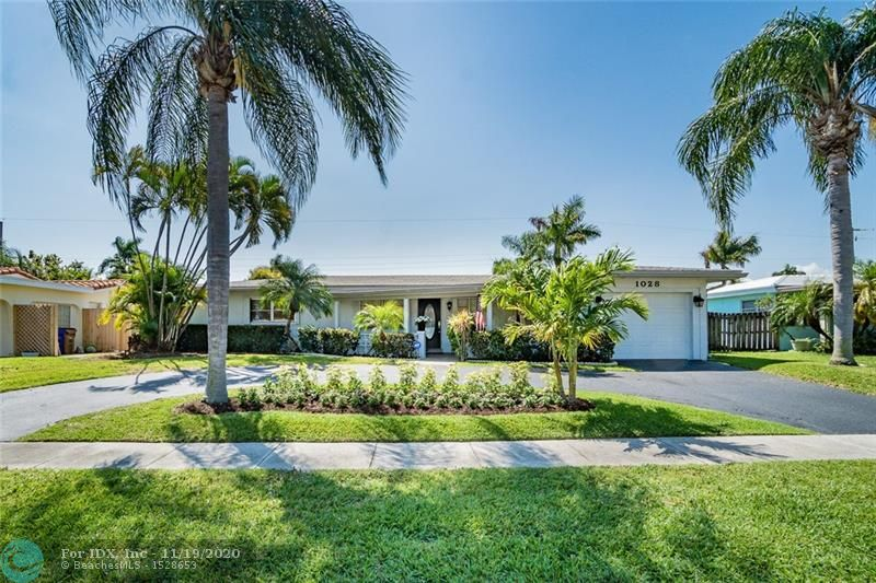 Welcome to the Cove, one of Broward County's most sought-after neighborhoods. Conveniently located on a quiet street East of US 1 and minutes away from Broward's most beautiful and accommodating beaches, shopping, and entertainment venues. The pride of ownership shows on this meticulously maintained 3/2 with a circular driveway plus a 1 car garage. Indulge in the peace and serenity of a large, fully and newly fenced backyard with a tropical pool. Upgraded landscaping and a freshly painted interior, new light fixtures, and ceiling fans, give this home a fresh, modern look. New high-quality laminate flooring in main living area and all bedrooms. Granite countertops adorn the spacious, family friendly, kitchen. Newer high efficiency A/C. An entertainer's dream, this home is truly a must see