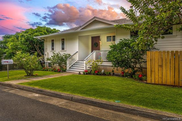 """Built in 2015, this contemporary yet classic Manoa home is timeless in style and features with the best """"smart home"""" technology incorporated.  Boasting a total of 4 Bdrms (one being a mother in law suite with separate entrance), 3 full baths, home office, offers touches such as high ceilings, open floor plan, large covered lanai, gas fireplace, central AC, hard surface flooring throughout, PV Solar, a chefs kitchen featuring a Thermador Pro gas range, bosh dishwasher, French door fridge, wine/beverage fridge, carrera marble countertops, walk in pantry, island, touchless faucet and so much more!  Enjoy beautiful valley & city views, watch the rainbows or sunsets from this exceptional location in the valley.  Quiet street w/ mango, citrus, noni and guava trees on property."""