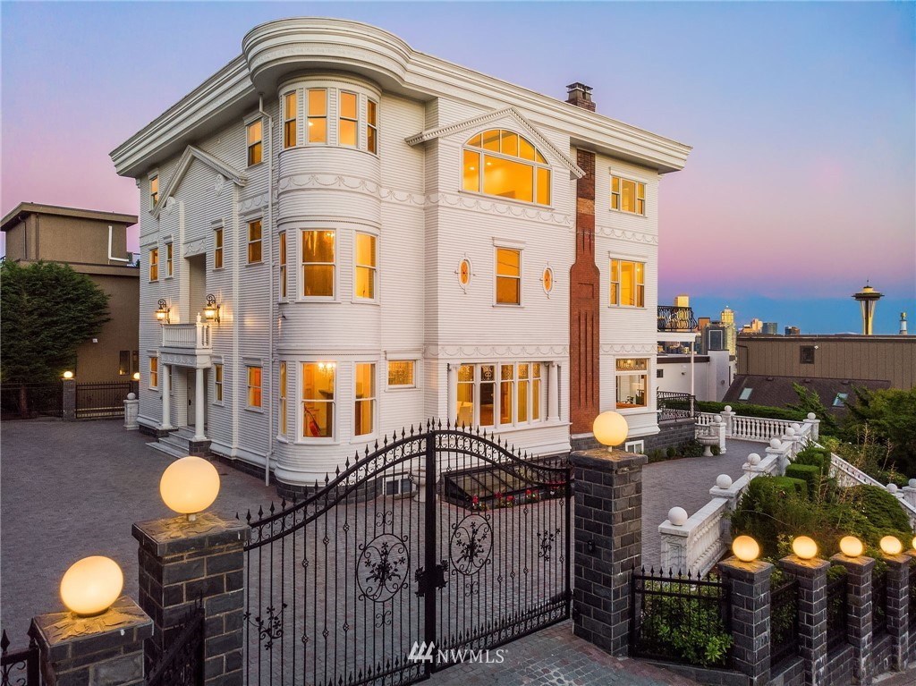 Since 1902, this stunning Queen Anne mansion has overlooked a city which grew into Seattle today. Originally built for Seafirst Bank founder W.J. Whitney, this historic home is unlike any other. Sitting at the highest peak in Queen Anne, the views may be the most breathtaking in all of Seattle. Entertain in the 3rd floor suite which has a bar, dining area, sitting area & provides 210° panoramic views of the Space Needle, Puget Sound & Lake Union. This meticulously restored nearly 10k sqft estate w/unrivaled construction has everything you need. Kitchens on each bedroom floor.  Enjoy movie nights in the 7 seat theater, workout in the gym or host guests in one of the many en-suite rooms. Gated with plenty of parking. The epitome of luxury.