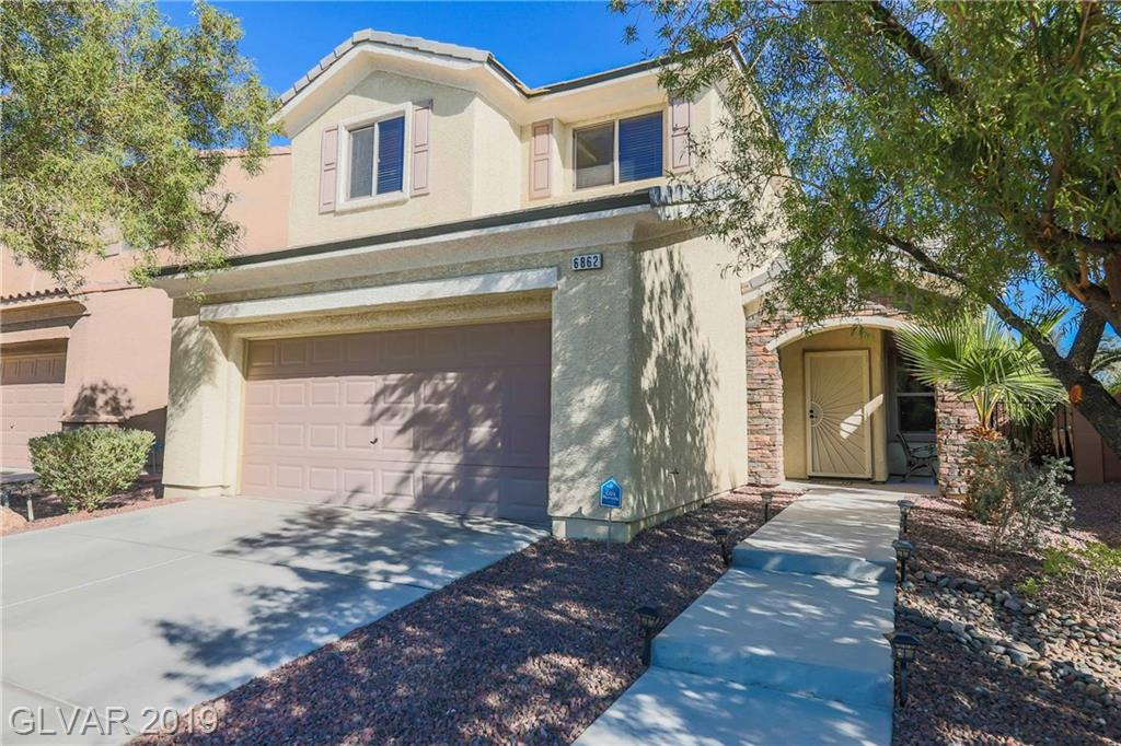 Stunning Pulte home in Aliante - completely upgraded! Great room plan open to gourmet kitchen. Great room w/entertainment niche, ceiling fan & diagonal tile. Gourmet kitchen w/staggered cabinets, wine refrigerator, island, granite, SS appliances/sink, dbl ovens, pantry. Mstr bdrm separate w/10' walk-in closet & ceiling fan. Mstr bath w/dbl sinks, separate tub & shower. Plus, computer loft, covered patio, no home behind, stuccoed eves, BBQ stub