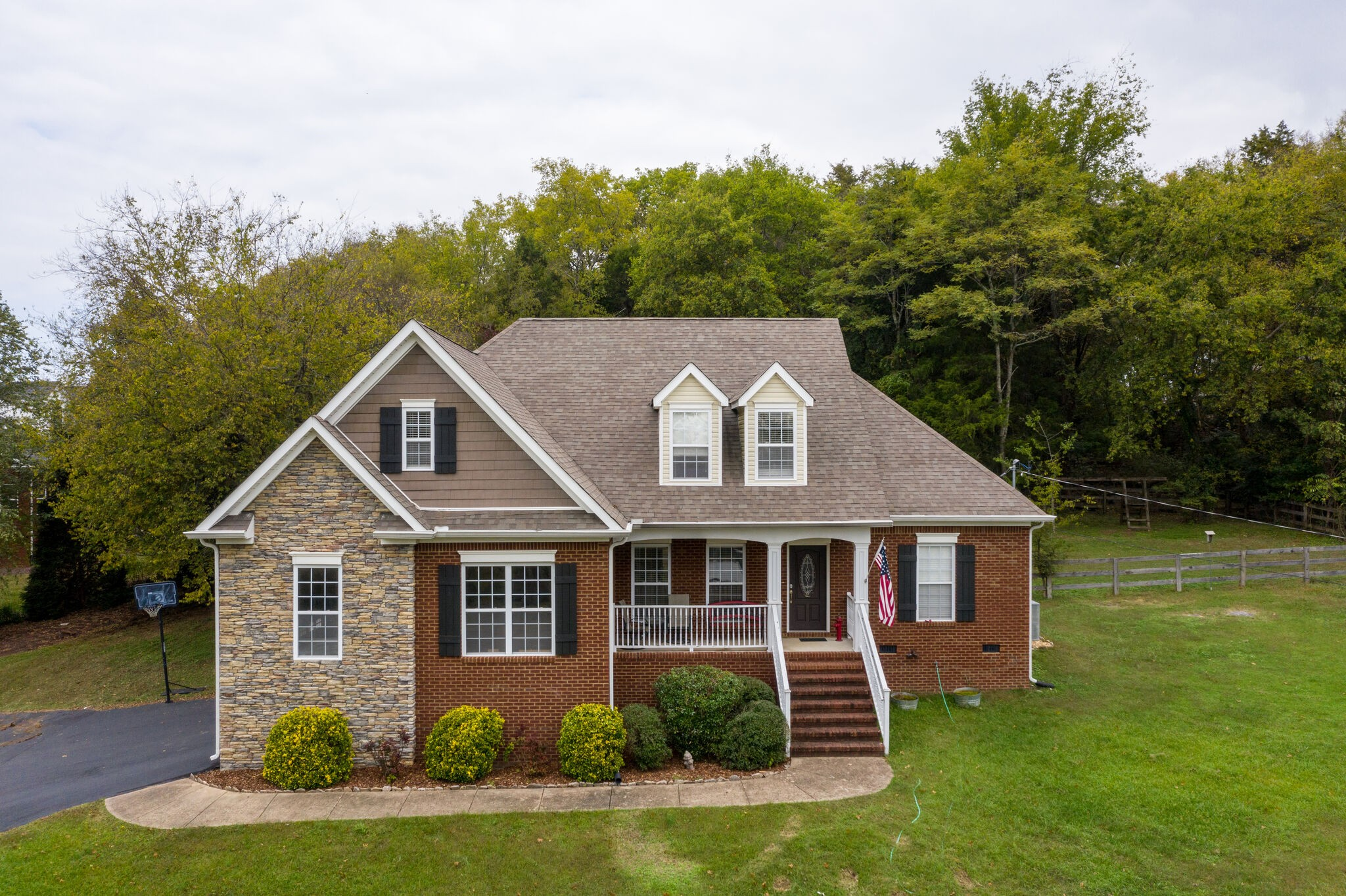 What an absolute wonderful home for you and your family. This 2749 Sq ff 4 bd 3 ba home sits nestled on a slightly sloped lot with a beautiful view. The back yard is private and quiet.  The lot is 1.07 acres and is great for kids and dogs to run on. New Carpet thru out the home and ready for a new owner. This is minutes from I-65 for the N/S commuter and shopping in Cool Springs and Spring hill area. This home can be yours before Christmas. Call today and lets get you a personal showing