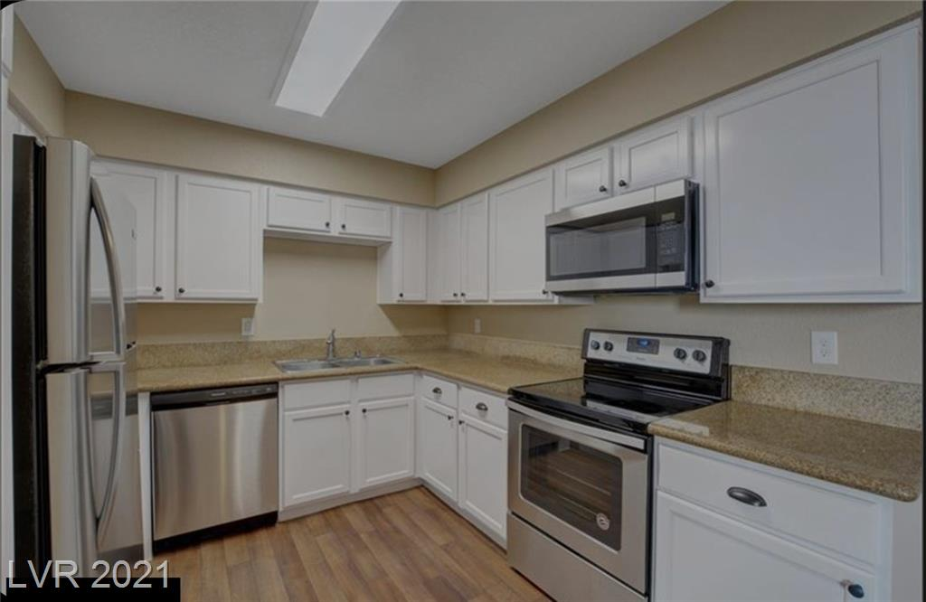 Enjoy the amazing Desert Shores amenities in this beautifully remodeled 3 bedroom, 2 bathroom condo! This corner unit features gorgeous granite kitchen countertops and new stainless steel appliances! Separate laundry room in the balcony, washer and dryer included. Walking distance to shopping, library, pristine lakes, beaches, jogging, biking, bus stops and more! Minutes from highways! Community has 2 swimming pools, a gym and a club house.