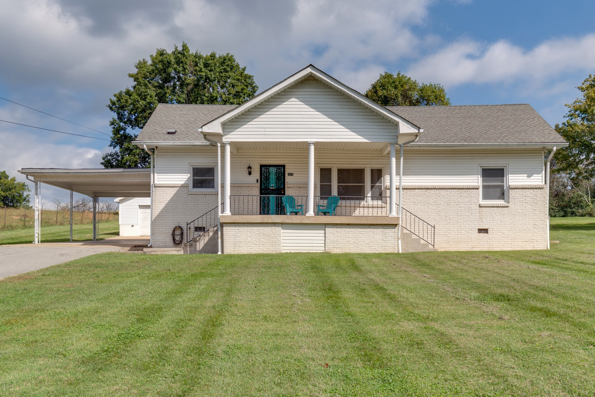 One word, LOCATION! Close proximity to Nashville Highway! Beautiful 1.23 acre lot, fenced back yard, detached garage/shop with a half bath, and large carport. This property has belonged to the same family for 50+ years and incredibly maintained! Spacious living, dining, and kitchen!