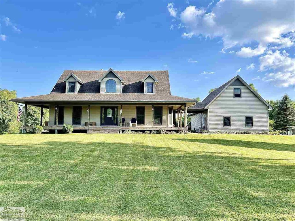 Look No Further This One Of A Kind Stunning, 1.5 Story Home Set On 5.6 Sprawling Acres Of Beautiful Trees & Wildlife! This Custom Home Features. Bullnose Corners Throughout, 1st Floor Master Ste, Beautiful Sunroom W/Skylights, & Panoramic View Of Your Backyard & Spring Fed Pond. Greatroom Complete W/Vaulted Ceilings, Wood Burning Fireplace, & Bass Wood Trim Throughout. Kitchen Features Custom Pine Cabinetry, Avian Contertops, & Prep Island! Office/Den On Main Floor W/An Adjacent Half Bath. Upstairs You Will Find 2 Bedrooms Both W/Dual Closets Along W/Full Bath. The Finished Basement Is One Of A Kind W/An Office, Pool Table W/Custom Shelved Tray Ceiling, Half Bath, Wall Fireplace, & One Of A Kind Custom Bar W/Granite. BSMT Also Features Lg Workshop, & Steel Studs. Home Includes Geothermal Closed Loop Heat, Generator Ready, Gutters Ran Underground To Stocked Pond, Detached 3 Car Garage W/Bonus Room, Shed, Sprawling, Wrap Around Porch. The Character Of This Home Is Impeccable!