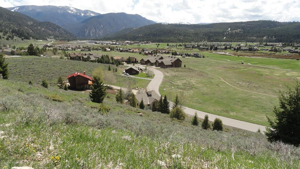 "This unique lot on Little Coyote has ""million dollar"" views because it's located above the road at the top of the hill. The views of the golf course, ski trails, Lone Mountain, and the Gallatin Mountains are spetacular. Agent owned."