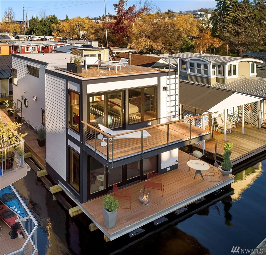 Spectacular newly completed home is the essence of sophisticated waterfront living.  SW exposure, roof top deck, enjoy panoramic views from S. Lake Union to Gas Works Park.  Wrap around ironwood deck with out-door shower.  Stunning modern open floor plan with custom details from lighting, fir cabinets and sliding doors to slate entryway.  2 Bedroom, 1.75 bath and office.  Generous master bedroom with large deck. Fisher & Paykel range, Caesarstone countertops and more.  Radiant heat throughout.