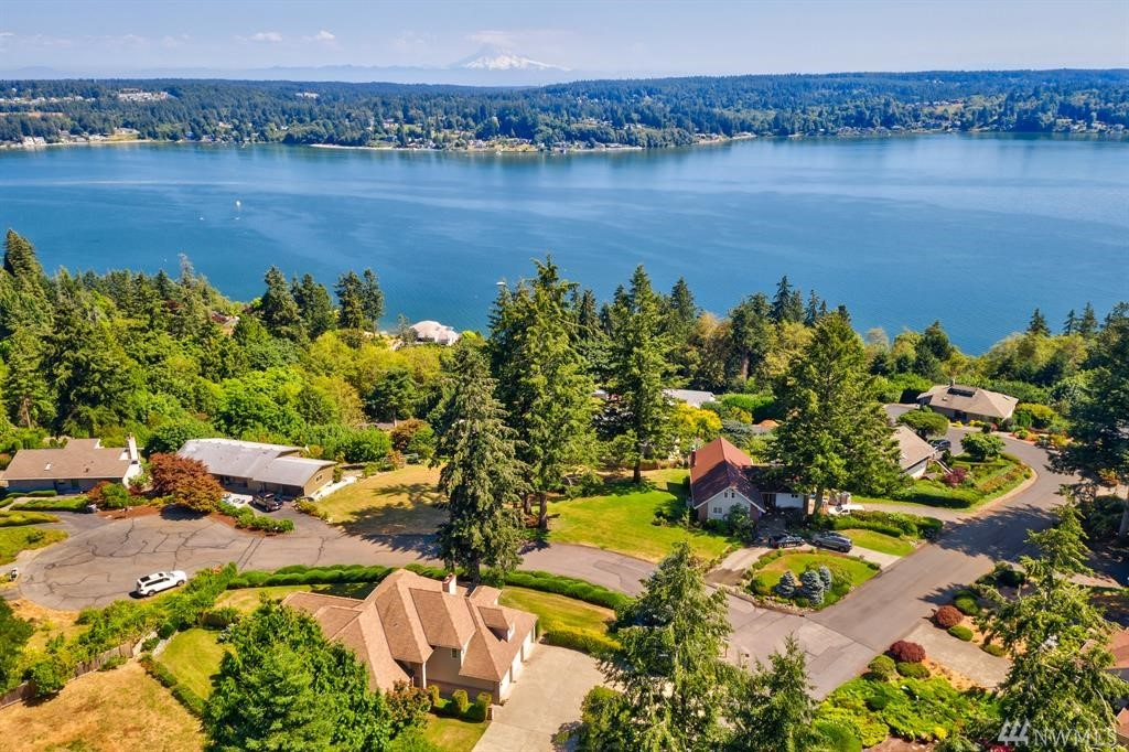 Unbelievable Views of Henderson Bay & Mt Rainier from this Emerald Shores custom home on 1/2 acre. Spacious 3613 sqft home has soaring ceilings, master on main w/ walk-in closet & 5 piece bath. Upstairs has 2 more bdrms, den or 4th bdrm, huge bonus room. Enjoy 3 fireplaces, heat pump w/AC, alarm system, speakers throughout, Trex decks, gazebo, oversize 3 car garage & RV parking. Watch fireworks, Orcas & boaters, or join them! Just 1 minute to boat launch and beach. 5 minutes to Gig Harbor North.