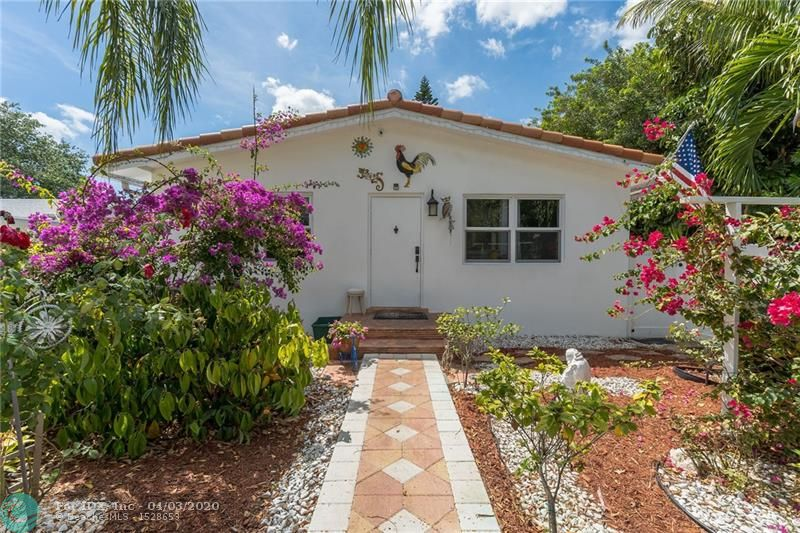 This gorgeous Dania Beach 2 bed 2 bath home was completely redone inside & out in 2016 w/ hurricane impact windows & doors, ac, roof, fence, paved driveway, covered hot tub area and more. New 32x32 white tile throughout the home goes great with the white kitchen cabinetry and granite counter tops. The Master bedroom w/ walk in closet and the ensuite bedroom were both recently upgraded. The 1 bed 1 bath seperated in law suite behind the home is perfect for keeping loved ones close. Both units have their own designated backyard area and separate electric meters. Only 5 minutes away from the beach and the parks. The area provides a variety of essential retailers as Walmart, Publix, Walgreens. This is also a great income property for Airbnb or annual rentals. NO HOA, trailers & boats welcome.