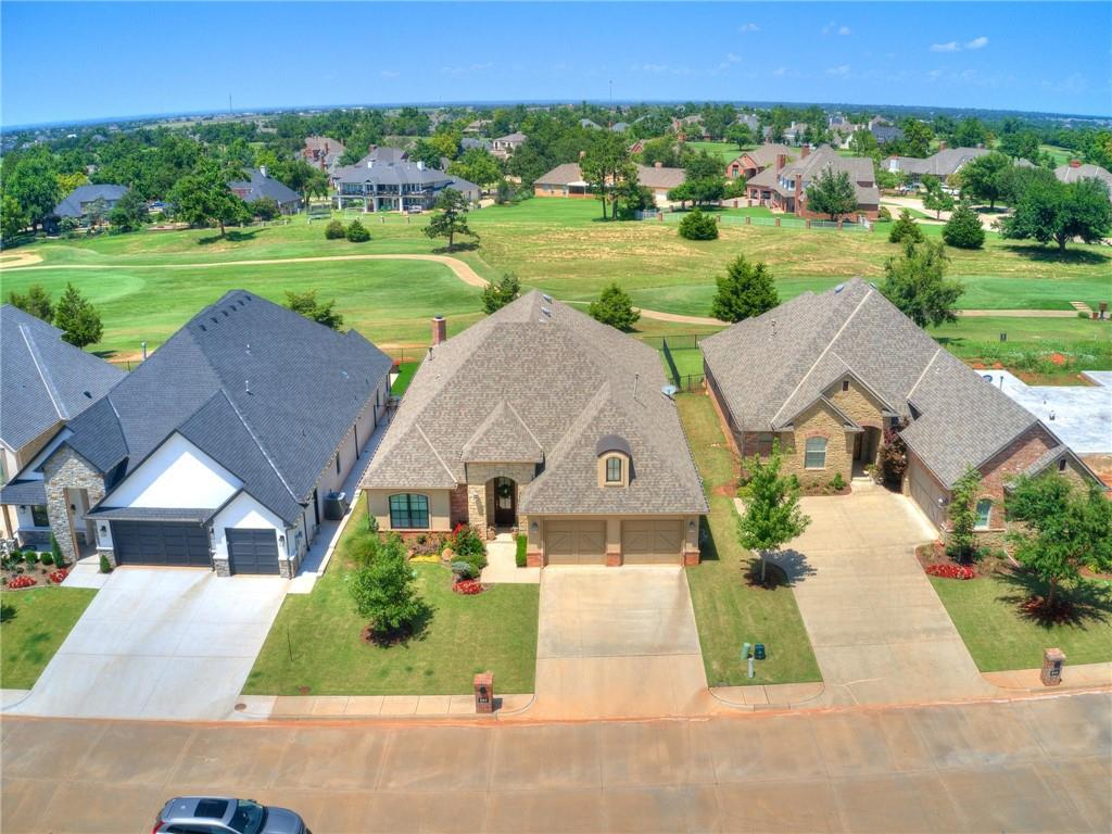 This TURN-KEY home is a hole-in-one! It is located on the 7th fairway of the Oak Tree East GOLF COURSE. Home has 3 bedrooms, PLUS an office or 4th bedroom, 2 ½ bathrooms, a 2.5 car garage with space for a golf cart, an impressive entry, BIG formal dining room, Large kitchen that is open to an informal dining space and living area.The kitchen boasts a HUGE island with a microwave, double ovens, 5 burner gas stove top with a griddle, and a wine fridge. Golf course views from the kitchen, living area and master bedroom. The large back patio includes an outdoor kitchen w/natural gas grill, outdoor fireplace, speaker, and gorgeous flagstone. The oversized master en suite hosts a walk-in shower, double vanities, jetted tub & large closet w/built-ins & safe that connects to the laundry room.Other amenities include wood floors, custom tile, surround sound, good-sized secondary bedrooms with walk in closets, plantation shutter throughout, sprinkler system and 2 zone well maintained HVAC system.