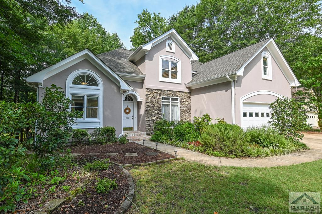 Are you looking for lakeside living close to town? This elegant home with wood floors and soaring ceilings and floor-to-ceiling windows offer a stunning view of the lake and woods in the backyard. Oversized owner's suite on the main with windows overlooking the water and a door to deck, dual closets, double vanities, vaulted bath with separate shower and jetted tub. The foyer opens to the dining room and a columned entry into a living room a with double-sided fireplace that opens to the living room and the kitchen. Windows run all along the back of the home with a view of the water. There is a spacious open room in the kitchen to providing ample space for everyday use and entertaining with a gas fireplace, updated kitchen area, space for dining, and a door with access to the deck. Upstairs there are two bedrooms each with a full ensuite bathroom. The second floor also has a large bonus room. There is a two-car garage and a deck off the back that opens to a wooded yard and numerous plantings. Ashton Place subdivision is an established neighborhood with walking trails, a lake, a large greenspace for playing ball or exercising your pet, and a pool. Minutes from shopping and dining.