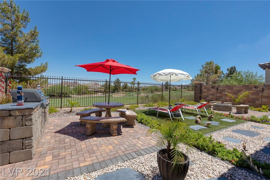 """Former Model built in 2019 on prime elevated pool size lot w/golf course & mountain views, beautiful sunrises and a short distance from the Recreation Center. Over $50,000 in upgrades include full length patio w/fans, beautifully landscaped rear yard w/built-in barbecue, stone table & benches, fire-pit, pavers & artificial turf. Kitchen has custom cabinets 32"""" & 40"""" uppers with 3"""" crown moldings, Quartz countertops in kitchen & primary bath, full backsplash, upgraded flooring & recessed lighting. Window coverings include solar shades, solar screens, shutters and blinds. Garage overhead racks. 45,000 sq. ft. recreation center w/ huge lagoon pool, lap pool, fitness center, indoor & outdoor basketball courts, racquetball courts, yoga room and pool room. Lounge area, Outdoor tennis & pickleball courts, volleyball court & playground. Community is home to the highly rated Chimera public golf course with clubhouse, restaurant & bar. Third bedroom used as office. Some furniture negotiable."""