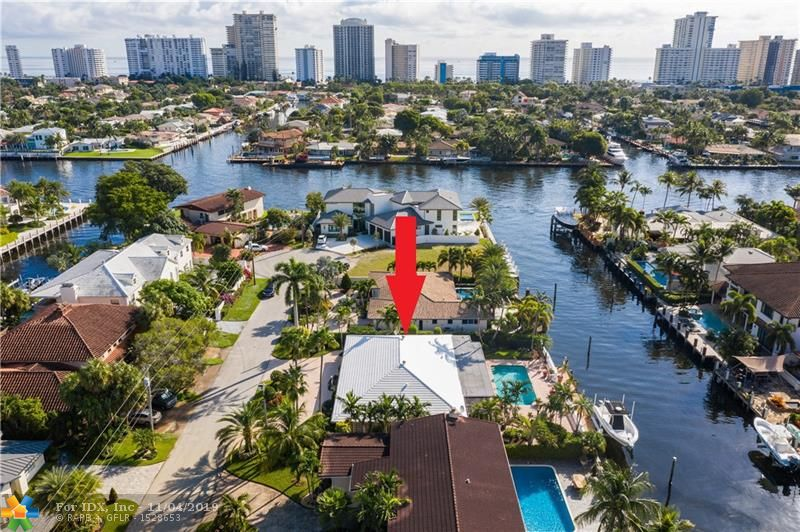 Absolutely gorgeous residence on 90 feet of prime no fixed bridges canal situated just 3 lots to the Intracoastal w/ desirable south exposure. There have been many elegant and quality updates made throughout the last few years. Custom eat-in kitchen w/ oak cabinets & stainless appliances. Kitchen is open to a wonderful family room w/ French doors leading you the most amazing 55 foot screened porch with hot-tub offering serene views of the waterway and heated pool area. Amazing over-sized master suite w/ sitting room, sumptuous master bathroom w/ double sinks & glass enclosed shower. Tasteful Porcelain tile flooring, crown molding and formal dining room. 80 foot dock w/ a 20,000 lb boat lift. This is one of the nicest streets in the neighborhood w/ beautiful curb appeal.