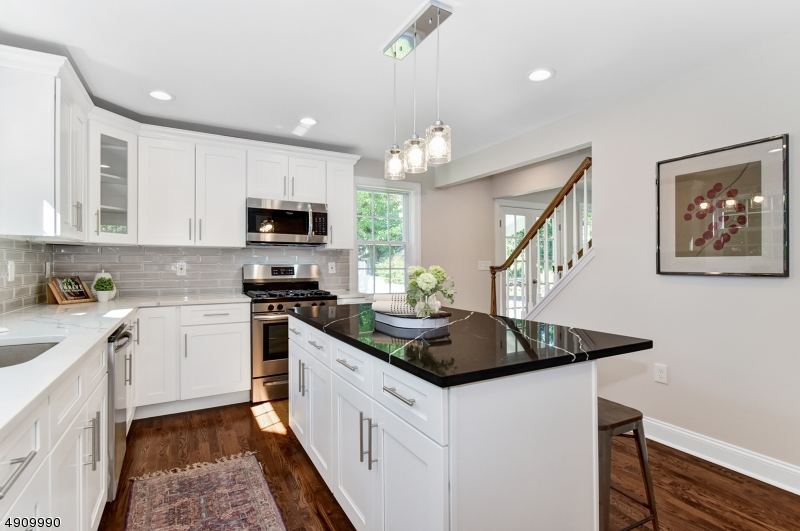"Completely renovated and enlarged in 2019, this home has all the ""right spaces"" and the gorgeous finishes that are in-demand by today's buyers. Convenient to NYC train, jitney, shops, schools. With 3000sf of finished space this house is ""like new"" including kitchen and baths, roof, plumbing, HVAC, hot water heater, electrical, siding, windows. Stunning white kitchen with center island, quartz counters, stainless appliances that opens to the adjacent family rm. The 1st floor bedroom is a great spot for overnight guests who can access the nearby full bath or it can double as a home office. The 2nd floor has all new hardwood flooring, 3 spacious bedrooms and two baths, including the master suite with WIC AND his/hers closets. Finished basement with half bath and rec room provides hang out space for all."