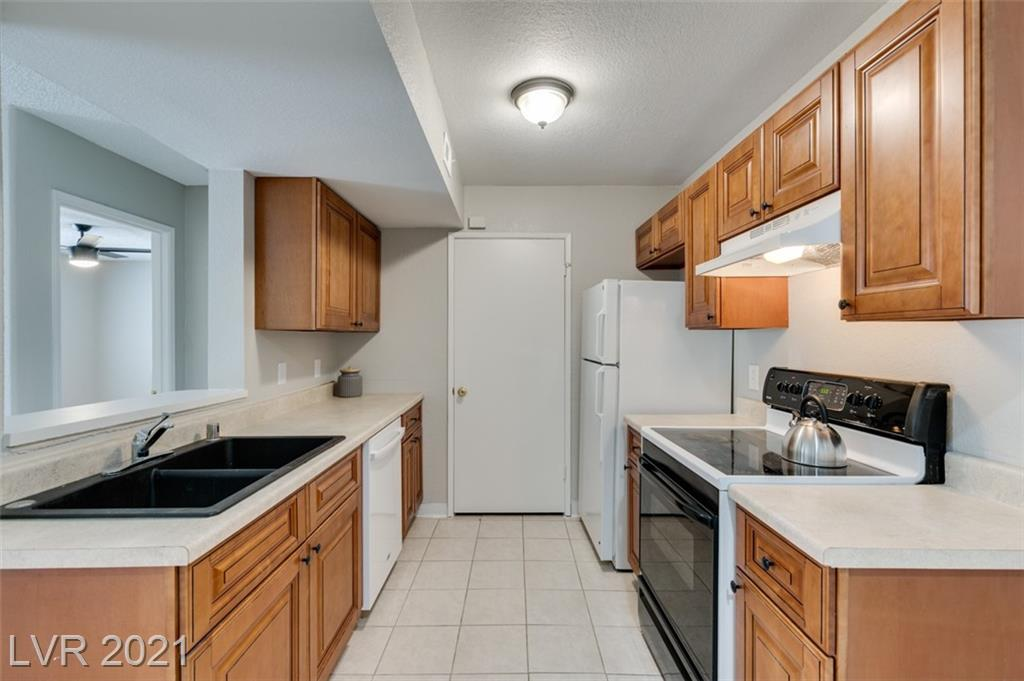 Beautiful 1st floor Condo in a Gated community with 2 gorgeous community pools, lots of open parking, an indoor spa, and an exercise room. The complex is close to shopping, easy access to 95. Recently replaced cabinets. Tile flooring throughout. Fridge, Washer Dryer included.
