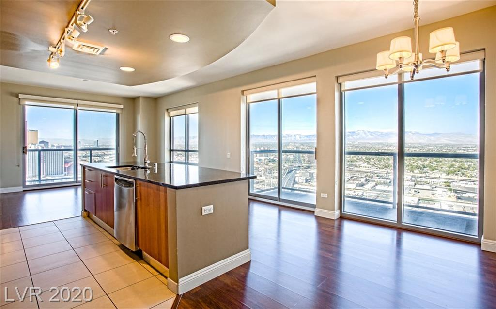 Priced to sell! This is the best price on the highest floor. Largest 2 Bedroom, 2 Bath Corner Unit at Allure with Incredible Strip & Mountain Views which can be seen from 2 Balconies. Unit in great Condition with  Upgraded  Wood & Tile Flooring, Granite Countertops, Breakfast Bar & Stainless Steel Appliances. Large Master Bedroom with Downtown View.