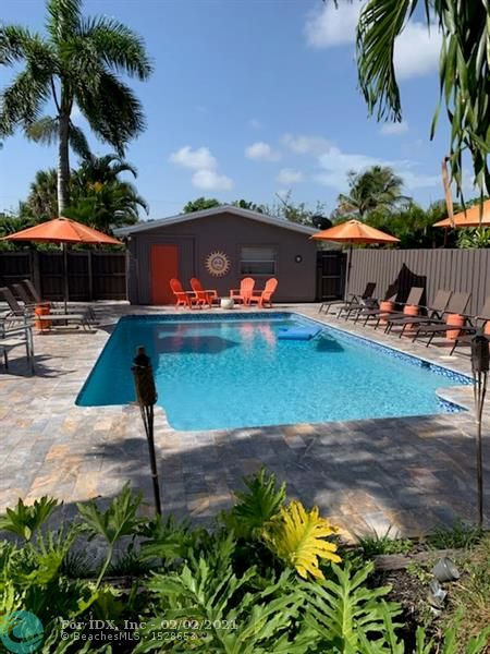 An incredible opportunity to own a very special estate style home in the heart of Wilton Manors. This property is over 11,250sf. The home has been significantly updated  but maintains its unique rambling beach cottage feel. Home also has a working fireplace. Major updates include a completely renovated separate guest cottage. The main house is a 3-bed/3-bath with porch. The home also has a heated pool,  enormous deck, spa & pergola which complete the estate experience.  This is also combined with a large landscaped garden for entertaining.  This is truly the perfect retreat.