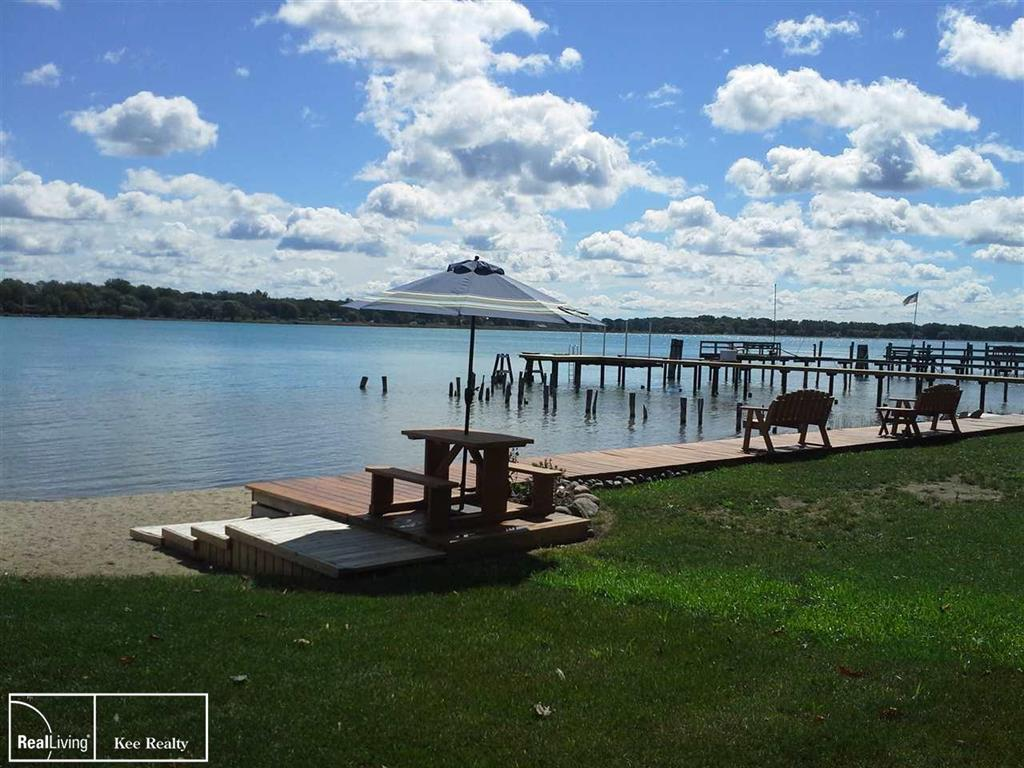 ATTN WATERFRONT LOVERS/INVESTORS - 13.77 ACRES: You will love this rare piece of property to build your dream home on the North Channel of St. Clair River. Perfect for your large gatherings with access to nearly 80' of private beach with built-in deck and picnic area. This may also be considered for future development opportunity. Subject to Township approval, the possibilities are endless. All utilities including Gas, Water & Sewer are avail. Breathtaking views as you watch the ships and freighters from all over the world pass you by. Magnificent sunsets at night. Entertain your friends and family with boating, fishing, swimming, picnics, reunions, bonfires, hayrides, dirt bike and snowmobile riding. Rear of the property backs to large bike path and state land and walking distance to Algonac State Park. Hurry on this one!
