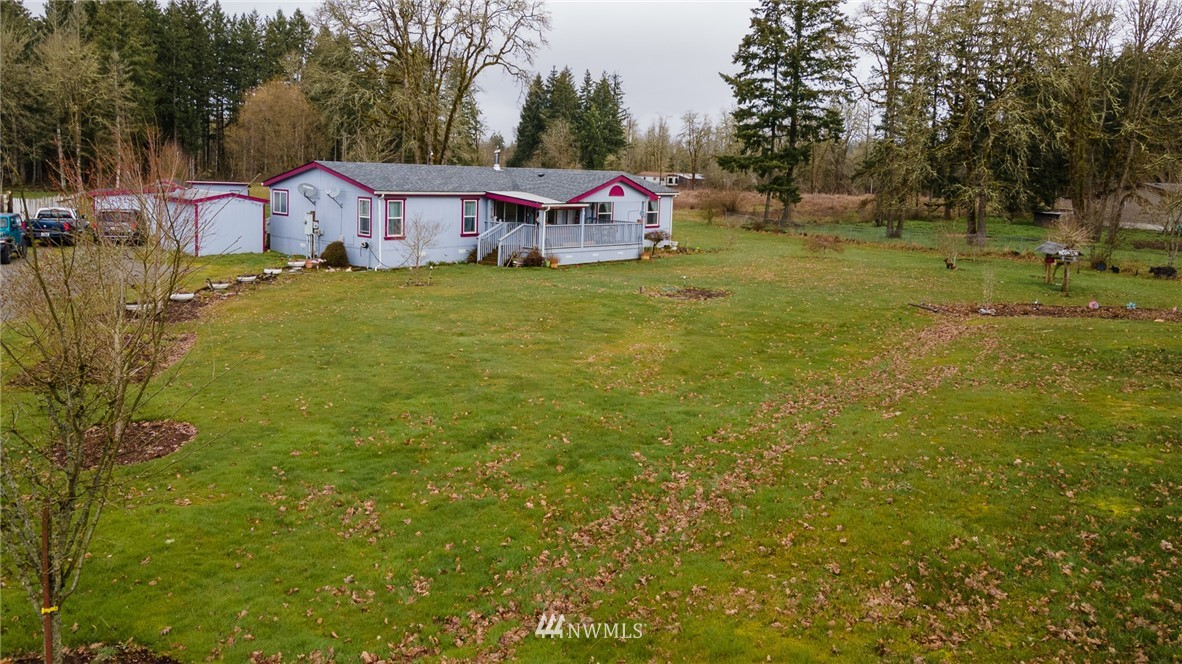 Great location just minutes from town and I-5 access. 1800+ sq. ft. home on 2.5 acres, 3 bedrooms, 2 baths. Spacious living room with wood stove, family room & dining room. Lg. master bedroom, master bath has soaking tub and separate shower. Vaulted ceilings, heat pump, A/C. Covered decks, wood shed, garden shed. Fiber internet available. Centrally located between Seattle & Portland.