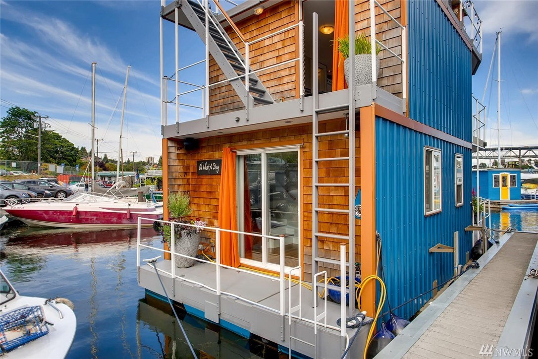 """""""Oh What A Day"""", Seattle Houseboat a modern houseboat living smaller living without the shock of """"tiny living"""". Impeccable finishes, design, decks on every level & full rooftop deck, incredible City views. Definitely not Sleepless in Seattle, you will be gently rocked to sleep every night. Main level full-size kitchen, living room and 3/4 bath, staircase to a second level master, 1/2 bath & laundry. Slip rent $520 +$200 liveaboard fee, includes water. Parking $35 (off-street first come)."""