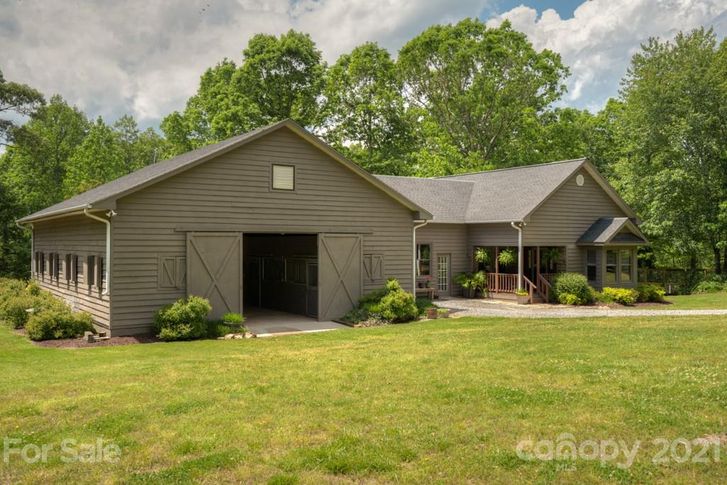 This is a dream come true! 18.61 acres just 2.5 miles from Tryon International Equestrian Center. 1425 sqft home attached to 6 stall barn, 3 paddocks (approx 100'x200' each) with 4 board fencing, pastures fenced with Electro-braid. Too many features to list here... please see attached features sheet to see all this property has to offer!  Approx 5.5 acres in pasture. Option to purchase additional acreage which would include 140' circular arena. Other than the house site, the remaining acreage is mostly in hardwoods. Beautiful stream meanders through the woods. Create your own trail system with this one-of-a-kind opportunity!   Copy & paste for video: https://player.vimeo.com/external/548132635.hd.mp4?s=8cf4dc4b746bd4c365e94e4829b5bf95afbe4ed2&profile_id=175