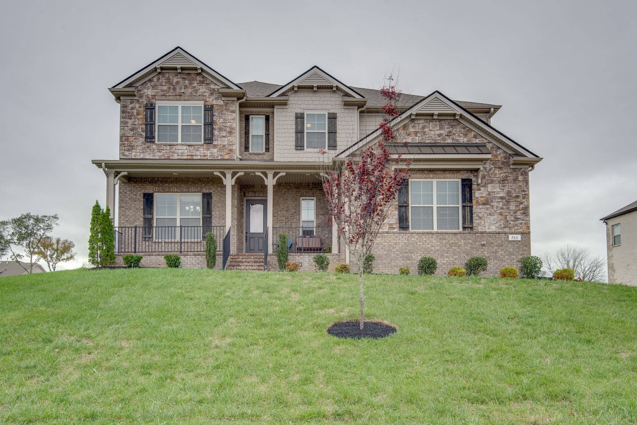 Beautiful 0.5 acre lot with great views, 5 bed/3.5 bath, 1st floor Master bedroom with sitting room/nursery, stacked stone fireplace, SS Electrolux Appliances, large front porch, irrigation system, Custom Master bedroom closet, 4 BR upstairs with living area, Large flat backyard.