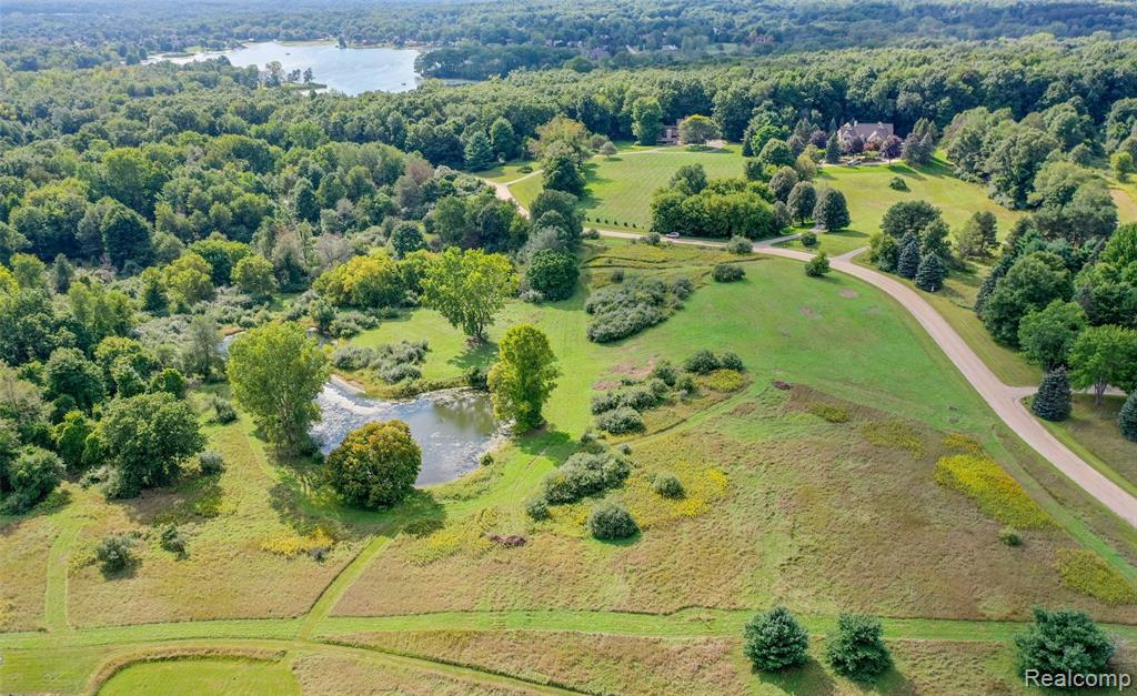 OVER 10 ACRES PRIME GENTLEMAN'S ESTATE SIZED LOT OF MEADOWLAND WILDERNESS WITH SPRING FED POND,5 MINUTES FROM HISTORIC DOWNTOWN CLARKSTON SHOPS,RESTAURANTS & AMENITIES!THE MOST BEAUTIFUL PROPERTY WE HAVE EVER OFFERED FOR SALE PROVIDES PRIVACY, GORGEOUS VIEWS, ROOM FOR ALL YOUR NEEDS & WANTS. BUILD YOUR LEGACY HOME AMID WORLD CLASS HOMES IN A PARK-LIKE NEIGHBORHOOD WITH AMBIENCE YOU CAN FEEL.HAVE ALL SEASON FUN HIKING, FISHING,SNOWMOBILING,HORSEBACK RIDING,SKIING,BIKING AND ALL-SPORTS WATER JUST MINUTES AWAY. UTILITIES AVAILABLE, SEPTIC AND WELL LOCATIONS IDENTIFIED. NATURE LOVER'S HEAVEN,NIGHT SKY IN YOUR BACKYARD,UP NORTH QUIET YOU CAN OWN.COME WALK THE ENCHANTING TRAIL OF THIS AMAZING DREAM PROPERTY.ENDLESS POSSIBILITIES,NONE LIKE IT!VACATION 365 ON YOUR PERSONAL PLAYGROUND, DESTINATION LOCATION SURROUNDED BY LUSH GREENBELT TO GARDEN, PHOTOGRAPH OR JUST RELAX! PERFECT PROPERTY FOR A HORSE AND BARN! Information Not Guaranteed Buyer Must Independently Investigate. Watch the Flyover!