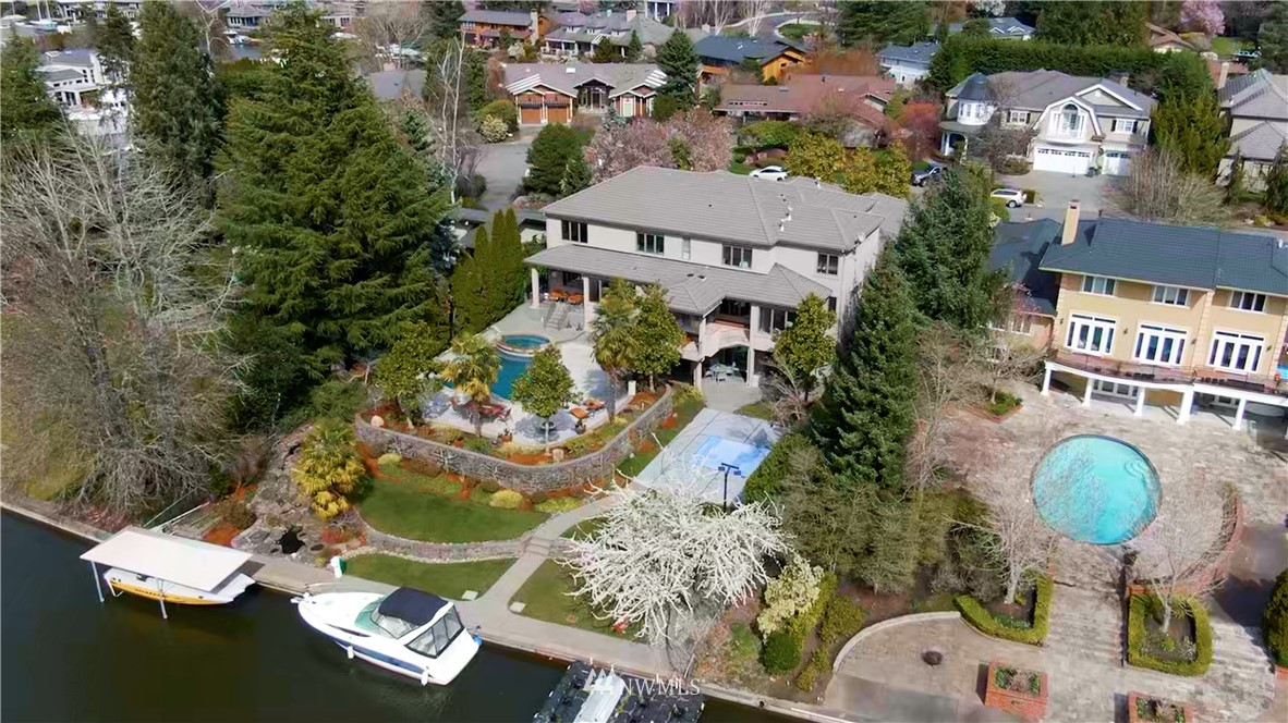 """Live the """"lake life"""" of your dreams - A resort lifestyle in the city! Exquisite SW facing FURNISHED waterfront property on one of the most desirable Kys in Newport Shores in Bellevue. This spectacular luxurious estate offers a blend of elegance, quality, comfort, & livability. Built in 2003, this 7,440 SF of luxury living has a master & den on the main, a 2nd master plus 3 en-suite bedrooms upstairs, theater & sports bar downstairs. The integrated indoor & outdoor living spaces, 90' waterfront with boat lift, pool, spa, outdoor BBQ, sport court, & neighborhood clubhouse, it has all the features for your own oasis. Easy access to I-90 and 405,  close to shops and restaurants. Excellent Bellevue schools. All furniture is included. A must see."""