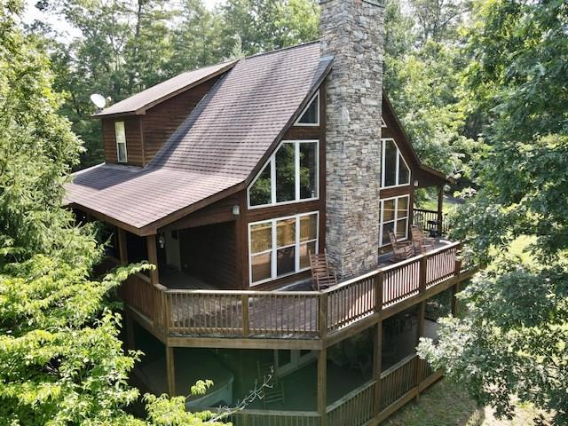 Located just 1.5 miles from the Parkway in Pigeon Forge and situated on 3 completely private and unrestricted acres! This is a one of a kind opportunity to own a piece of the Smoky's with the potential to expand. Turn key ready, fully furnished, and income producing! Boasting over 2,400 square feet, this tri-level cabin with 3 beds and 3 baths has plenty of room for everyone! Featuring hardwood floors, vaulted ceilings, stacked stone wood burning fireplace, wet bar with game room, and spacious bedrooms including a large master on the main level. New upgrades include new composite decking on the lower level and a new hot tub. All cedar exterior with level land and ample parking, this place is truly one of a kind! Call today to schedule your showing.