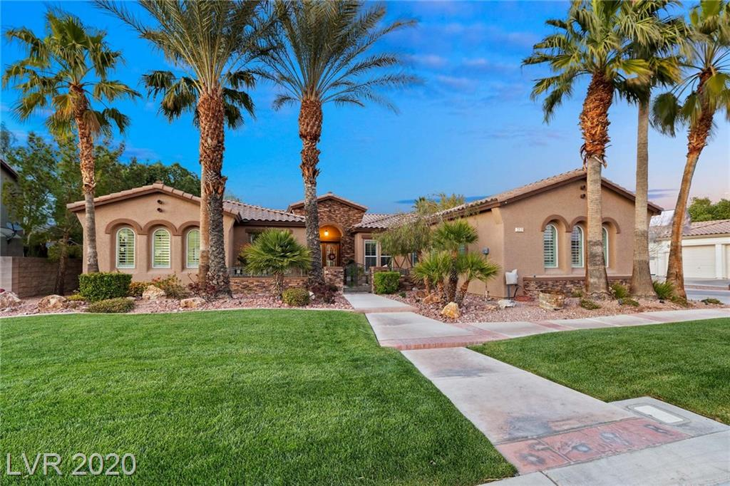 Exceptionally upgraded, single story home sitting on over half an acre in Silverado Ranch. Custom, full length glass wall leads you to backyard paradise with pool, spa with waterfalls and slide. Custom patio with built-in heaters, custom BBQ, fireplace and TVs. Custom kitchen with SS appliances, custom island with pop-up outlets. Fully custom bar in living room great for entertaining with wood wall. Koi pond in front porch, RV parking.