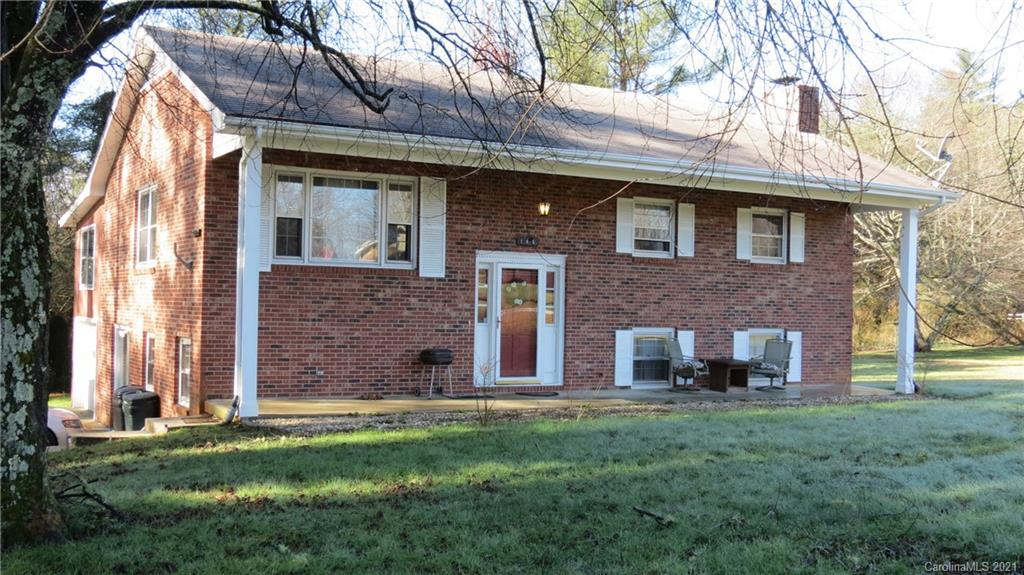 This charming split level home is located only 12 minutes from downtown Hendersonville and has quick easy access to Interstate 26.  This 4 bedroom 3 bath home is located on nearly half an acre of level yard.  Plenty of room for children, pets, or entertaining friends and family.  3 beds and 2 baths on the main floor with a beautiful sunroom overlooking the sizeable back yard.  Wood floors throughout the upper level with kitchen, dinning and living open floor plan.  The lower level is complete with 1 bedroom, 1 bath, kitchen, family room, and laundry/mud room.  Great for the larger family or rental opportunity.