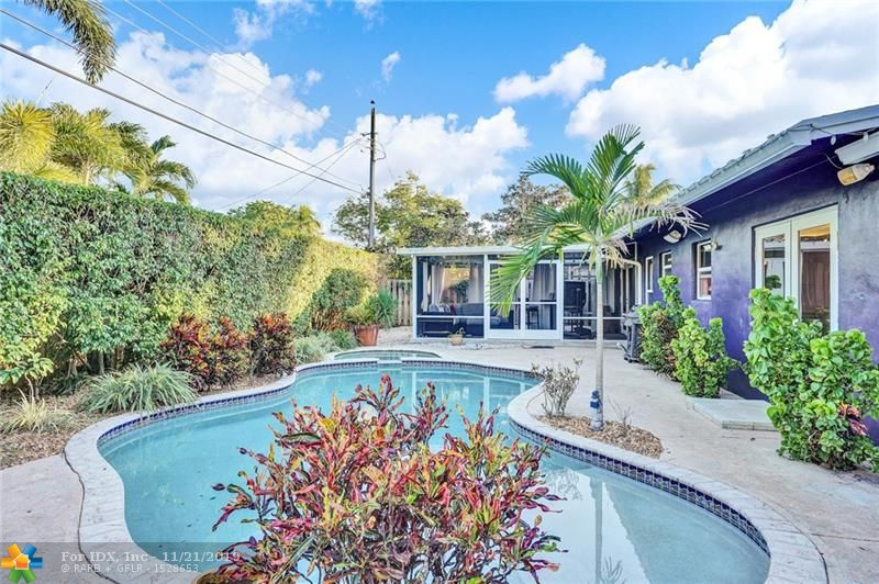 Updated 3 bedroom 2 bath + pool home nestled on a quiet street in Wilton Manors. Impact windows and doors! Light and bright open floorplan with bamboo flooring throughout living areas. Kitchen boasts quartz countertops, stainless steel appliances and wood cabinetry. Backyard oasis features spacious screened-in porch (permitted), pool and spa surrounded by lush landscaping. Big laundry room + storage. Centrally located in Wilton Manors! Minutes from Wilton Drive, shopping, dining and entertainment. This home is a must see!
