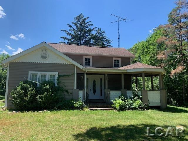 Renovated farmhouse on 2.6 acres of land.  Vaulted ceilings.  Large porch.  Detached 3 car garage with mature trees.