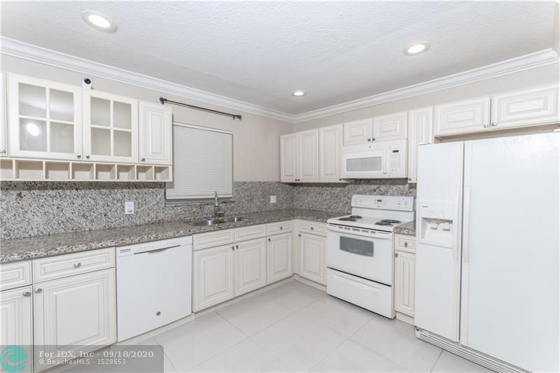 Spectacular 2/2 corner unit at Riverside Estates. Completely renovated ready to move in located in the heart of Coral Springs. IMPACT WINDOWS throughout, tastefully design kitchen with wood cabinets and granite counter tops. Tile floors throughout, new 2018  water heater and  AC. Newly renovated bathrooms, and lots of extra  storage on balcony. This Cozy unit has it all and is perfect to start a family.  Great Location, walking distance to supermarkets, schools, shopping centers and restaurants. It Will Not Last!!!