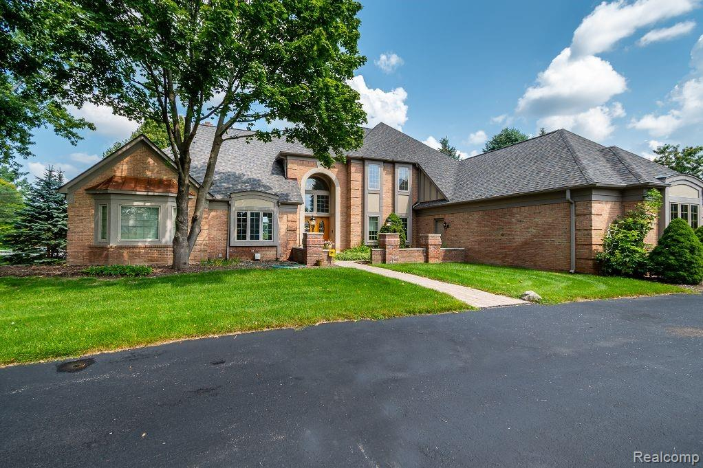 Attention to detail in this very custom all-brick built home on estate size 1.5 acres with 200 feet of private waterfront.  Architecturally designed for optimal picturesque lake views.  Mable foyer with open vaulted great room, extensive premium woodwork and built-ins throughout.  Desirable entry level master suite with pan ceilings, private bath and large walk-in closet, 2 fireplaces, quality kitchen with washed oak cabinetry, large island, granite tops, newer hardwood flooring, Sub-Zero refrigerator.   Maintenance free decking.  Beautifully finish lower level walkout with entertainment size bar, media room, dark room, private hot tub room, sauna and bath.  Newer maintenance free decking.  Circle driveway.  Don't wait!
