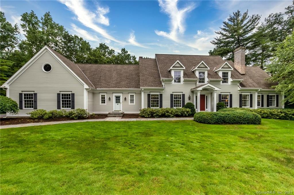 This striking dormered Cape is set peacefully on a quiet cul-de-sac in the heart of West Simsbury! Detailed and finely finished, this home will exceed your expectations with a first floor master bedroom and marble bath with heated floors & soaking tub, a private study, and beautifully decorated living and dining rooms. The chef's kitchen is a dream with oversized island, luxurious granite, upscale appliances and a sun-filled, vaulted dining alcove all open to the cathedral family room with wetbar via a pass thru floor to ceiling gas fireplace. Leading from the family room is a stunning heated and cooled sunroom with cathedral wood ceiling, fan and access to a private deck overlooking a lovely patio, lawn and stone wall accent! There are two half baths and a laundry on the main level. Upstairs are three spacious bedrooms and two additional bathrooms plus walk in storage areas. Amenities include rich wood floors, cove lighting, speaker system, French doors, whole house auto generator, c-vac, walk out lower level ready to be finished! Walk to Tulmeadow Farm and ice cream stand and Simsbury Farms Recreation complex with golf, swimming, tennis and hockey! Simsbury is the place to be!