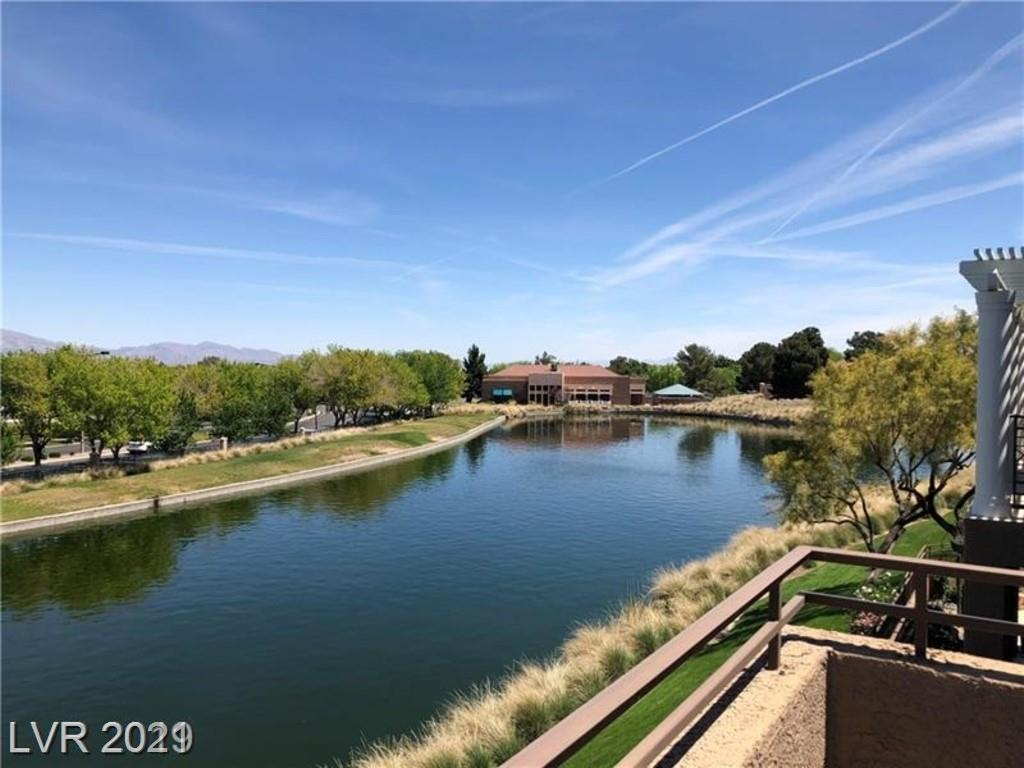 THE BALCONY HAS A DIRECT VIEW TO THE POND. THIS BEAUTIFUL CONDO LOCATED IN A LUXURY GATED COMMUNITY WITH COMMUNITY POOL, SPA. 2 CAR GARAGE. HIGHLY UPGRADED MODERN BATHROOMS, GOURMET KITCHEN W/ STAINLESS STEEL APPLIANCES, BRIGHT AND COZY LIVING ROOM WITH A FIREPLACE,