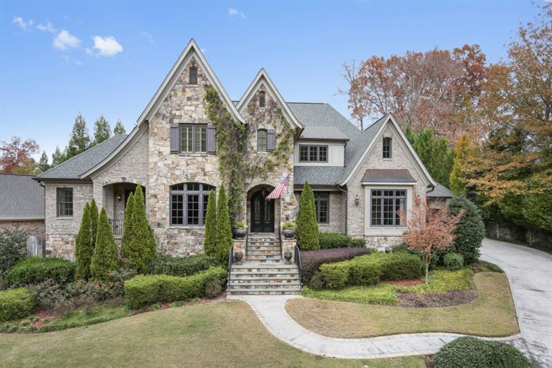 Quality abounds in this custom-built European estate nestled one block from Chastain Park. Gorgeous fireside master-on-main w/ spa bath & his/her closets. Finished terrace level featuring in-law suite, 2nd gourmet kitchen & air temperature controlled wine cellar. Four upstairs ensuite bedrooms, including au pair suite. Impeccably charming walk-out backyard w/ heated saltwater plunge pool & green space. Beautiful custom details including wood-beamed ceilings, wood & stone inlay flooring, 2-story foyer, & garage parking for 4 cars. Incredible value in prime location!