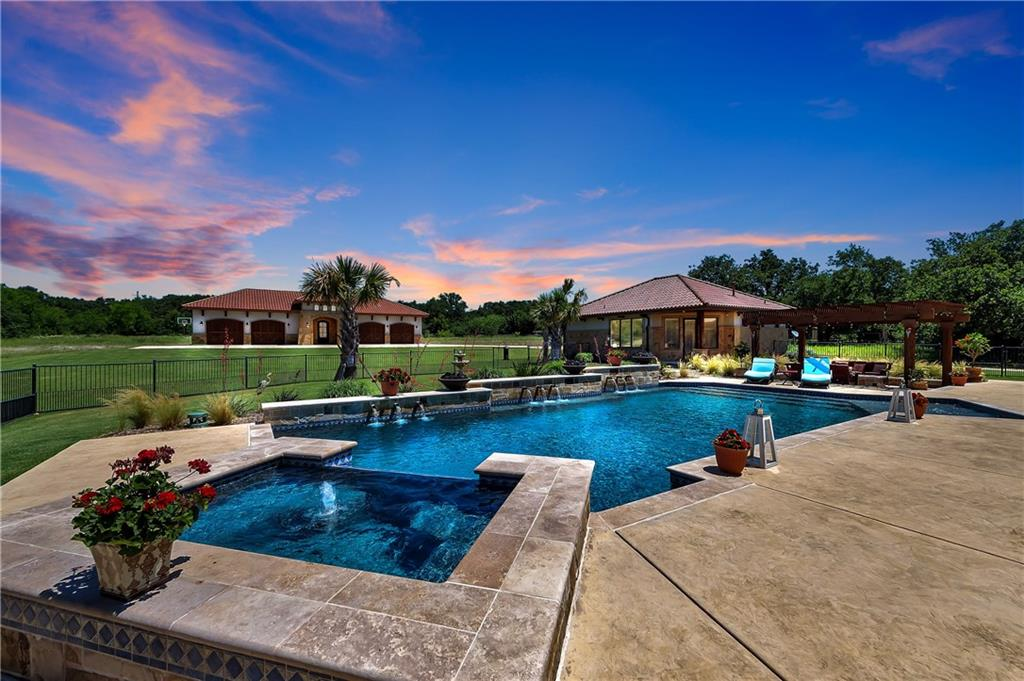 Resort Style Simply Stunning, close to DFW airport, this gated stupendous very private 8.3 Acre Mediterranean Estate offers a well stocked pond, wireless audio video system, hand scraped hardwood floors, large granite island & wine bar.The Main home boasts 5000 sq ft of exemplary, luxurious living including Master suite with two custom closets, exercise room. Walk outside & engulf yourself with spectacular outdoor living w heated pool spa, colossal patio with fireplace, flat screen, electric shades, pergola & super grilling area. Main house with 3-car & single garage.The 1000 sqft Casita has kitchen w full bath, bedroom, family room. Over sized climate controlled 4 car garage & large shop with new LED lighting.
