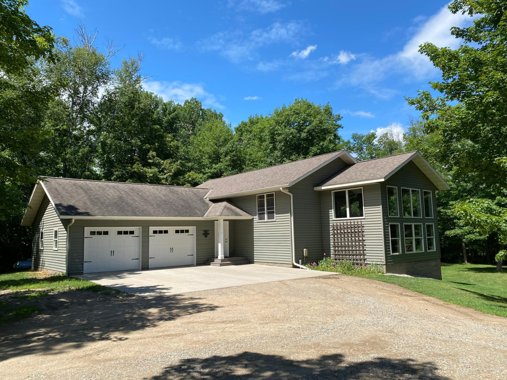 Super home with open floor plan that is a must see, vaulted ceilings, new appliances, newer deck, walkout patio, 2 garages, gardens, all minutes to Grand rapids. Very private spot near many lakes like Pokegama  chain.