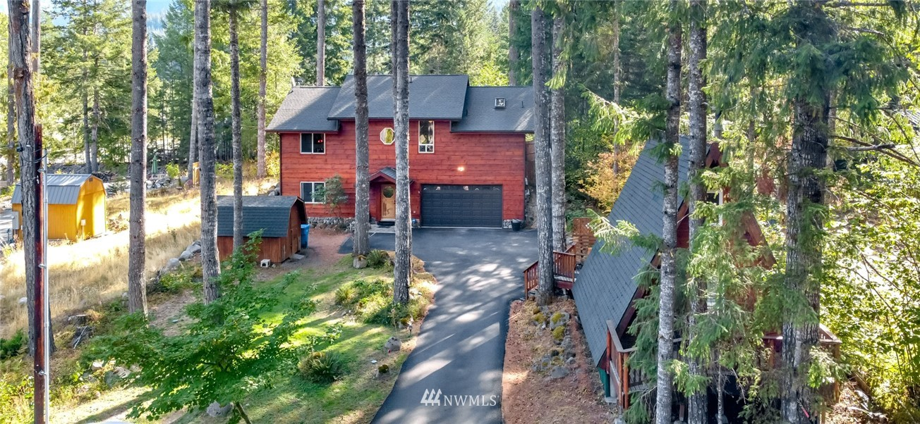 Welcome home to this elegant cabin in Packwood! This 3 bedroom, 2.5 bath home is teeming with upgrades including distressed softwood floors, custom hand-carved wood throughout, Bose sound system, skylights, & wet bar on the main floor with fridge - perfect for entertaining! The kitchen is light and bright and boasts walk-in pantry, serving bar, granite counters, and stainless steel appliance package including built in oven, microwave, and separate built-in gas range - any chef's dream! Relax in the luxurious master suite featuring state of the art steam shower, vaulted fir shiplap ceilings, & private deck access! Entertain personal or Air BnB guests in the detached A frame cottage with kitchenette! This one is an absolute must see!