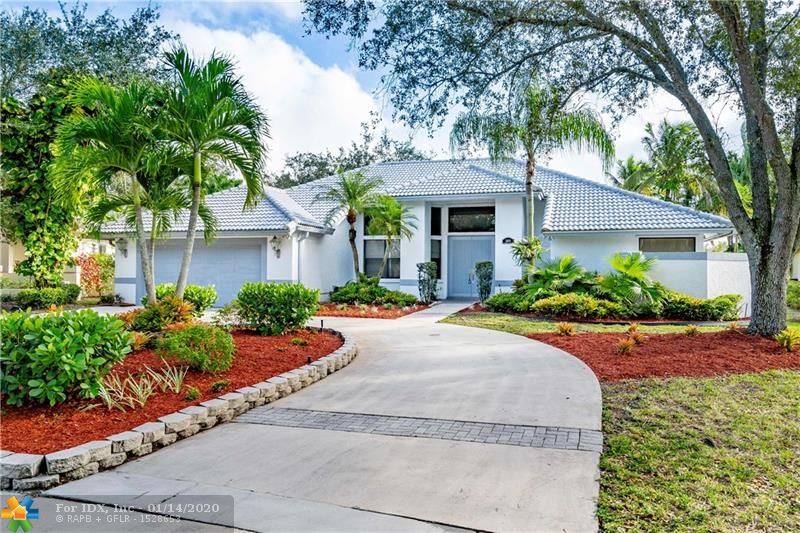 Welcome home to the exclusive gated community of Tequesta Trails in Weston! This immaculate 4 bedroom, 3 bathroom home sits right on the lake on a private cul-de-sac, and features a private screened in pool (with spa). Soaring, vaulted ceilings with brand new electrical fixtures throughout the home. Beautiful, waterproof vinyl floors just installed in all of the bedrooms, and new stainless steel appliances in the kitchen. The fourth bedroom is a guest suite that has it's own private bathroom and access to pool deck. Come see it today!