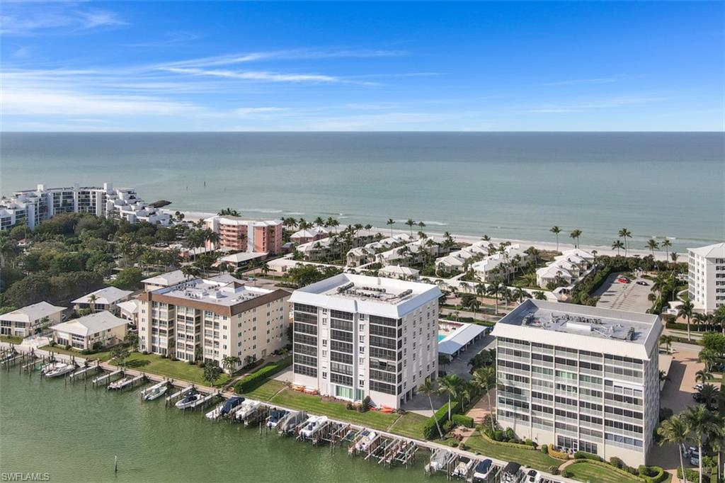 Partial Gulf-view in a sought-after boutique building with easy beach access. Just steps across Gulf Shore Blvd is the beach access and only minutes on the inlet to the Gulf of Mexico with no bridges. 2 spacious master bedrooms and 2 baths plus a great room/dining area of 1,650 square feet. Neutral Tile floor throughout. A modern style kitchen and large lanai with partial Gulf view. (The western terrace has sliders on the exterior and is encompassed by the main living space). Electric shutters and Impact sliders offer storm protection for the western facade. One covered, deeded parking space #2; one storage closet #27. Impeccable. The Windemere has completed a total renovation of the lobby and all corridors. Building amenities include a full-time manager on site, community pool, and grilling area. Boat access to the Gulf at Doctors Pass is unobstructed by bridges. Beach access just across Gulf Shore Blvd. N. Don't look any further if you love walking the beach and taking the boat out for fishing or cruising.