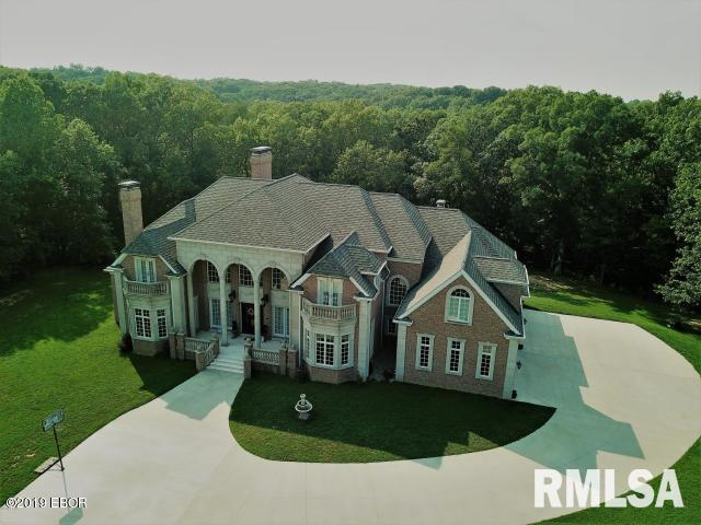 Beautiful Pristine Custom Home built by Linus Rapp Construction in highly desired Woodlawn School area that sits in the middle of 10 private wooded acres. Be amazed by the impressive design luxury finishes with the Brazilian cherry flooring and over 9' ceilings. Gourmet kitchen w/abundance of cabinetry, granite, SS appliances, built-in sub-zero refrigerator, Wolf gas stove w/grill and warming drawer, huge island, great pantry too! Vaulted ceilings in the main living areas helps bring in the light from outdoors. Plenty of room for family and guests with 5 Bedrooms, each with own bath. Additional features of this luxury home include smart home lighting, Audio system, (4)Geo thermal units, sound proof media room, wine cellar. Luxurious master suite w/spa like master bath and amazing closet. Kitchen appliances, Washer & Dryer, Hot tub, All TV's