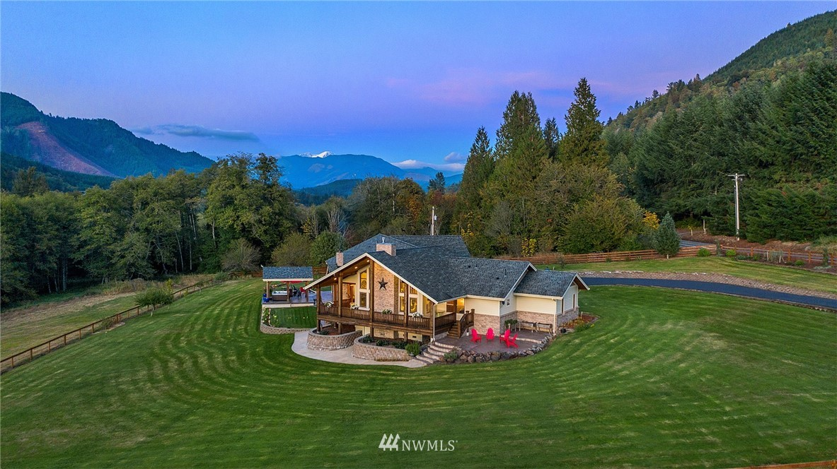 Nestled in the Cascade foothills, spanning over 65 acres, this quintessentially Northwest ranch has been built and maintained at the highest standard. The immaculate 2010 single-level home was designed for seamless indoor-outdoor living between the comfortable, yet spacious, interior rooms and the expansive covered porch with outdoor fireplace and pizza oven. Updated in 2019, the barn features new electrical throughout and new metal roofing and siding. The 40x48 shop provides safe keeping for your motor coach or horse trailer. Less than an hour from White Pass Ski Resort and surrounded by lakes, forests, pristine rivers, and refreshing mountain air. This is the land of outdoor possibility.