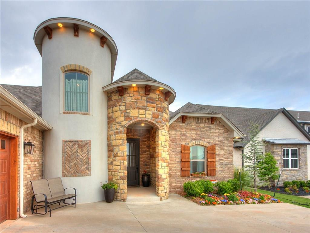 You have to see this beauty with impressive double turrets! The turrets create a dramatic entry & a gorgeous stairwell leading to an upstairs gameroom.  You'll be struck by the lovely open living area which includes a gorgeous masonry rock fireplace and in the kitchen is a large island, quartz counters, stainless appliances, built-in china cabinet & a walk-in pantry. The large master suite is beautiful & functional, with double vanities, an amazing walk-in shower & super huge walk-in closet, that connects to the laundry room....which connects to the garage hallway & drop zone cabinets! All bedrooms are downstairs and the upstairs gameroom has a powder bath & additional office space. Evenings will be so enjoyable on the spacious covered patio. The neighborhood pool & clubhouse are available for residents to enjoy.