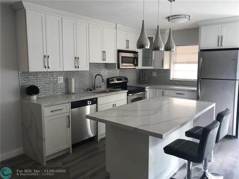 Fully renovated new 1/1.5 immaculate kitchen, bathroom, floor, and freshly painted. Breath taking view to the golf course. With community pool and within walking distance to all Cooper City Schools! The best A + schools in Cooper City. Motivated Seller! This unit will go fast!