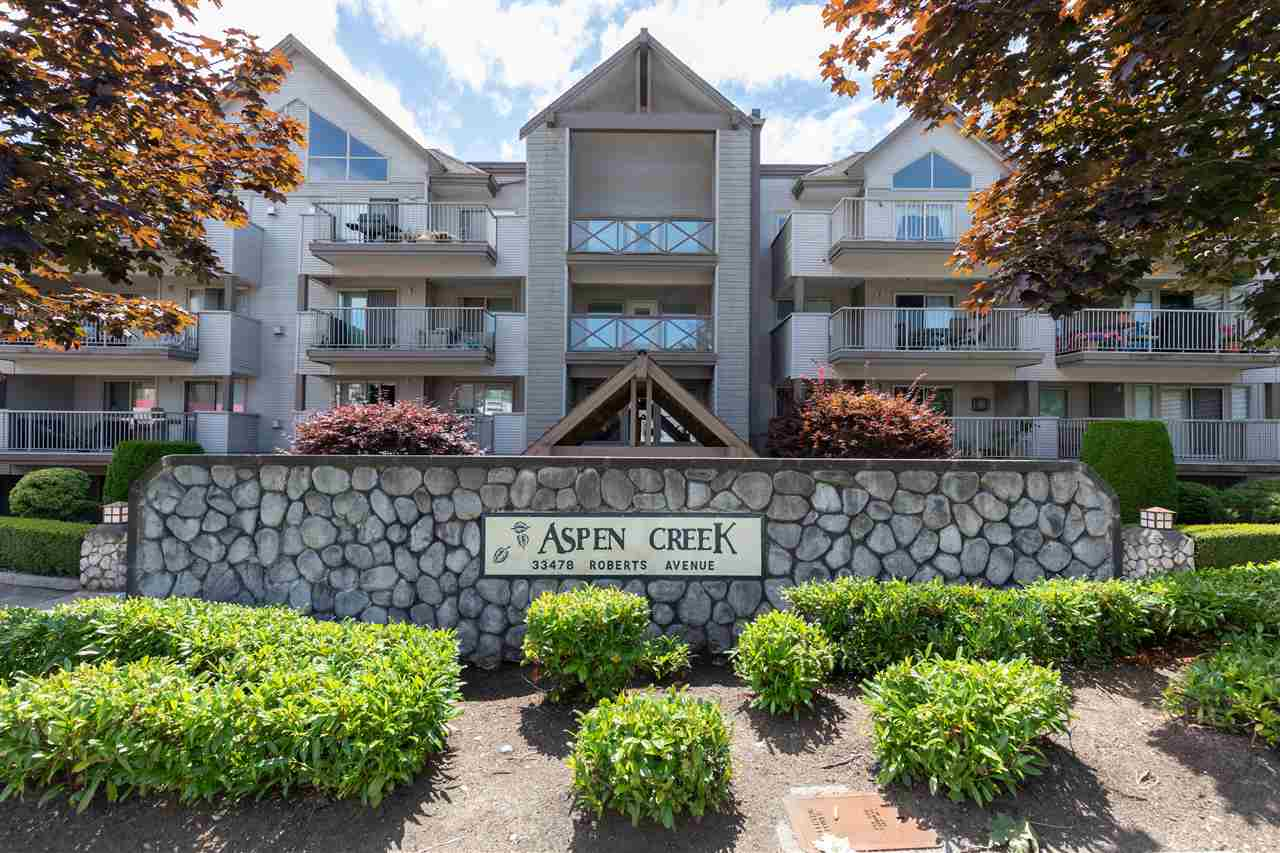 Be whisked away by the nature and sound of the trees blowing from the balcony!! Top Floor VAULTED 2 Bedroom and 2 Bathroom apartment at Aspen Creek in Central Abbotsford. Rarely for sale are these SOUTH facing units as they boasts a functional 941 Sq FT floor plan, view backing onto the trees, and true privacy. Fully renovated here with nothing to do but move in. New laminate and tile flooring throughout, updated kitchen with backsplash and quartz countertops, bathrooms with tiled showers, and stoned floor to ceiling gas fireplace. Spacious bedrooms on opposite sides and a full in suite laundry/storage room. Massive balcony with two seperate seating areas which is ideal for entertaining or relaxing. 2 side by side underground parking spots and a storage locker. Well maintained strata.