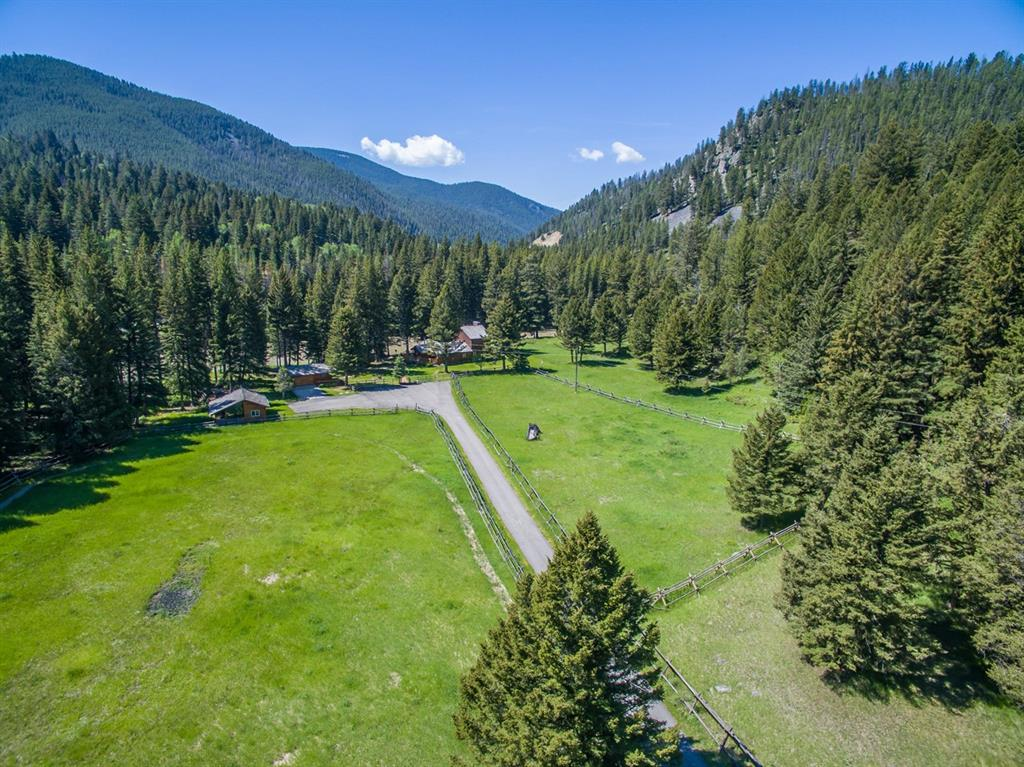This is an extremely rare vacant lot right on the banks of the Gallatin River! This 4 acre lot is on the opposite side of the highway, accessible year-round by the private Gold Gate bridge. With over 300 feet of river frontage, this parcel is a dream equestrian and/or fisherman's paradise!